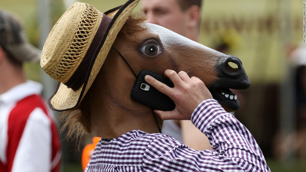 A fan in a horse mask talks on his cell phone before the Preakness Stakes in Baltimore on Saturday, May 17.
