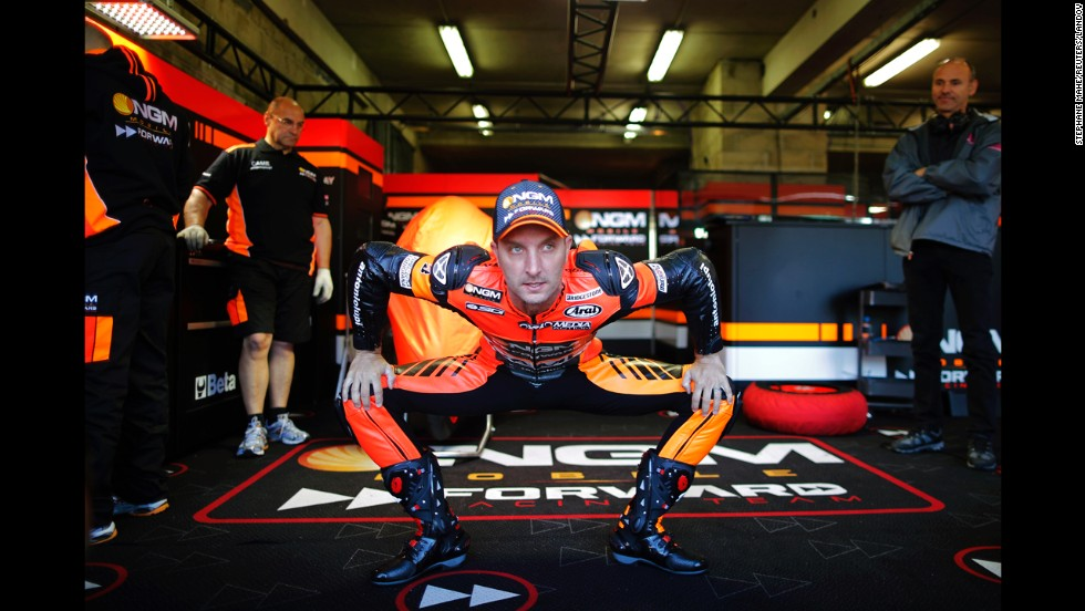"MotoGP rider Colin Edwards is seen in his garage before a practice session Saturday, May 17, at the French Grand Prix in Le Mans, France. The race was won by Marc Marquez, who has won all five MotoGP events this season. <a href=""http://www.cnn.com/2014/05/13/worldsport/gallery/what-a-shot-0513/index.html"">See 41 amazing sports photos from last week</a>"