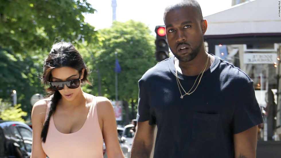 Before their May 24, 2014 wedding, lovebirds Kim Kardashian and Kanye West pretty much took over Paris. Here, the couple -- who often enjoy matching one another -- took a pre-wedding stroll in the City of Light on May 19. This moment's pretty kute, but how does it stack up against these other PDA-filled moments?