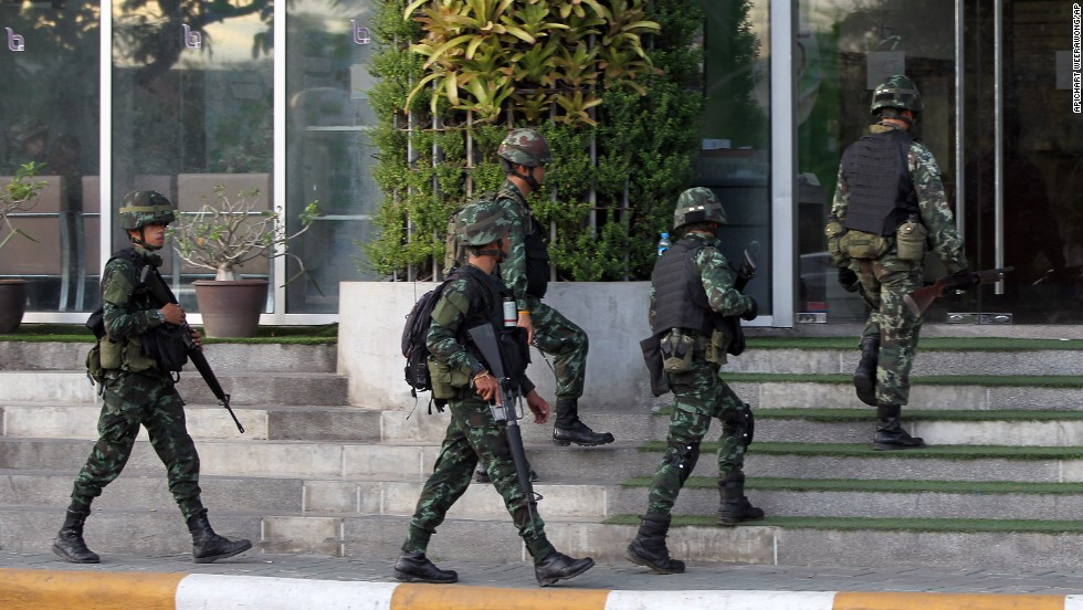 Thai soldiers walk into the National Broadcasting Services of Thailand building on May 20. All Thai TV stations were being guarded by the military.