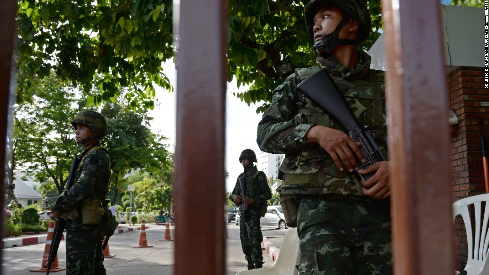Thai soldiers stand guard outside the Government Public Relations Department in Bangkok on May 20.