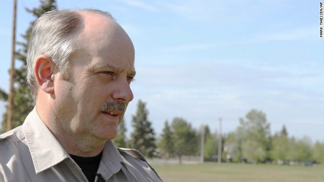Mark Sledge, the senior Joint Base Elmendorf-Richardson conservation law enforcement officer, spoke after a woman was attacked by a brown bear.