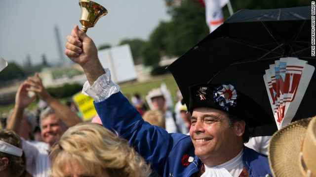 In this September 10, 2013, file photo, tea party activists cheer during a rally in Washington.
