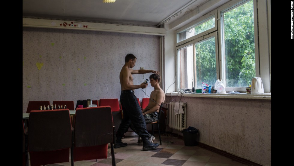 A new recruit gets his hair cut at a training camp for the Donbass Battalion, a pro-Ukrainian militia, in the Dnipropetrovsk region of Ukraine on May 19.