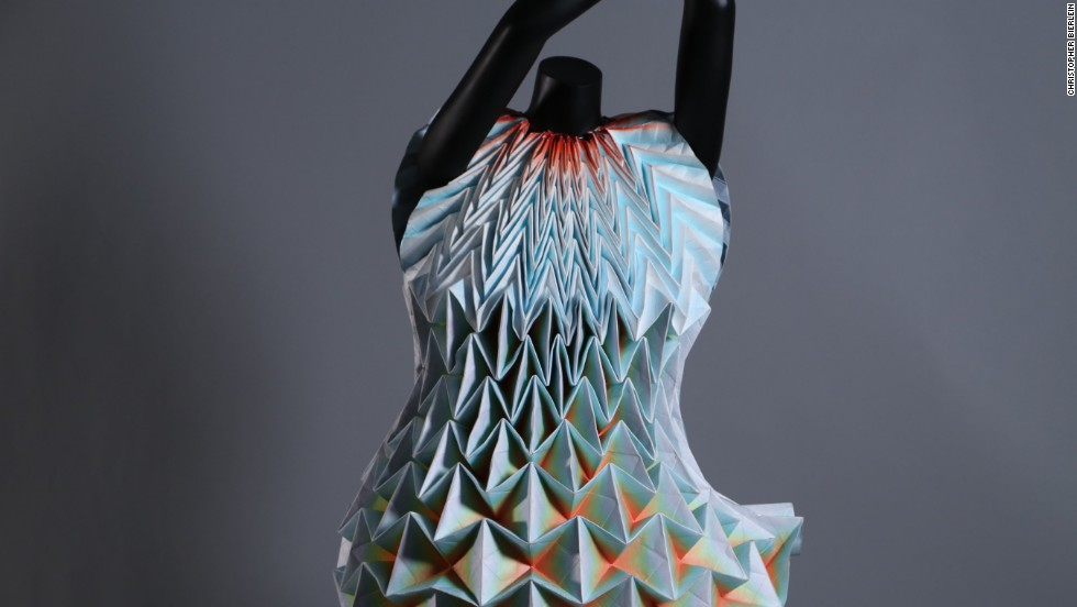 """I am also showing the many genres of origami, including a fashion segment, which isn't typically considered to be a standard category of origami,"" Nguyen says. Shown here is the ""Enfaltung"" dress by designer Jule Waibel ."