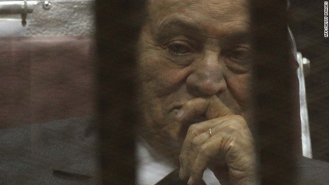 Egypt's deposed president Hosni Mubarak looks on from behind the accused cage during his trial on May 21, 2014 in Cairo. An Egyptian court sentenced Mubarak to three years in prison on corruption charges, in one of two trials after the 2011 uprising that ended his rule. AFP PHOTO / HASSAN MOHAMEDHASSAN MOHAMED/AFP/Getty Images