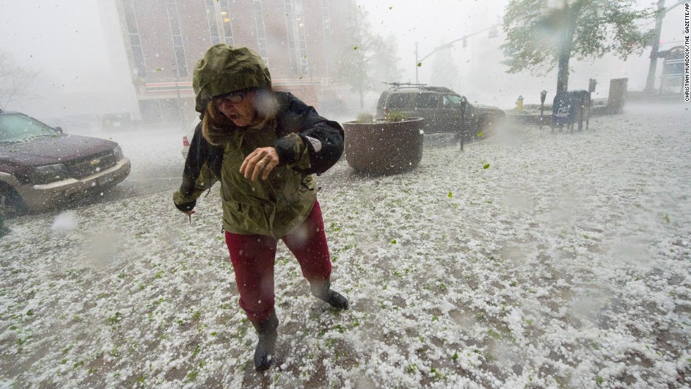 A pedestrian runs for safety as a hail storm hits downtown Colorado Springs on Wednesday, May 21. The storm was part of a fierce weather system -- featuring baseball-sized hail and multiple tornadoes -- that ripped through Colorado.