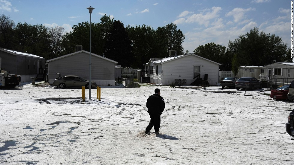 Joe Furnari walks through Woodshire Mobile Park in Aurora after the hail storm on May 21.