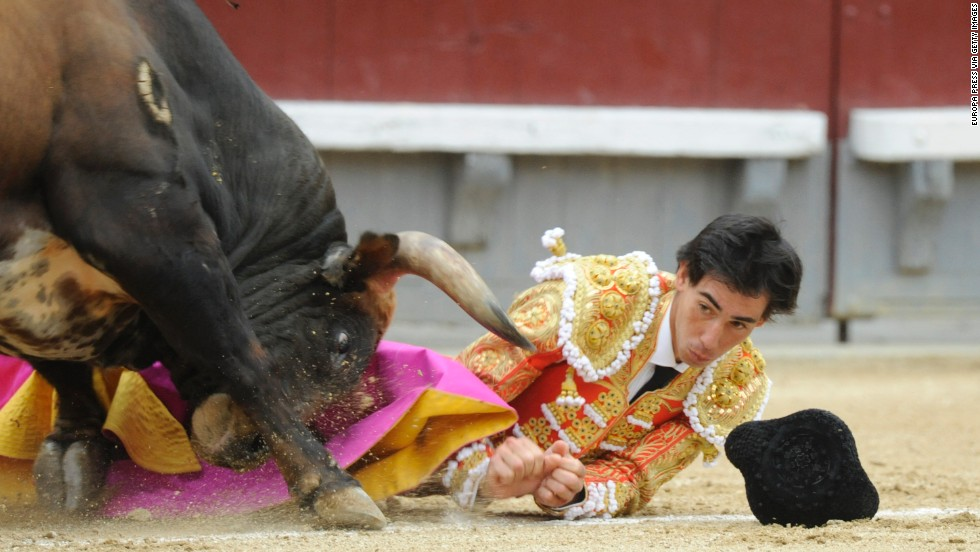 Jimenez eyes the horn of a bull as he is gored on May 20.