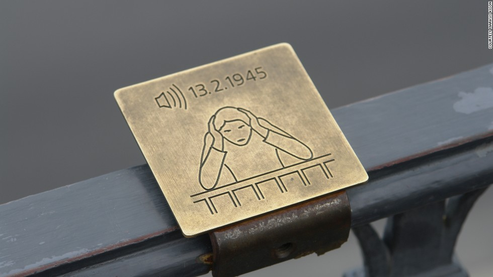 "Artist <a href=""http://markuskison.de/"" target=""_blank""><strong>Markus Kison</a></strong> found a haunting new use for bone conduction technology: allowing visitors to Dresden, Germany to relive the horrors of the city's WWII air raids. At a silent observation deck, visitors can look out over the city, while placing their elbows on the railing and cupping their ears to hear the screeching airplane engines and exploding bombs."