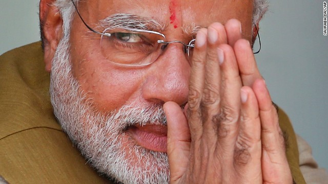 Opposition Bharatiya Janata Party (BJP) leader and India's next prime minister Narendra Modi greets the gathering at the home of his 90-year-old mother in Gandhinagar, in the western Indian state of Gujarat, Friday, May 16, 2014. Modi won the most decisive election victory the country has seen in more than a quarter century and swept the long-dominant Congress party from power, partial results showed Friday.