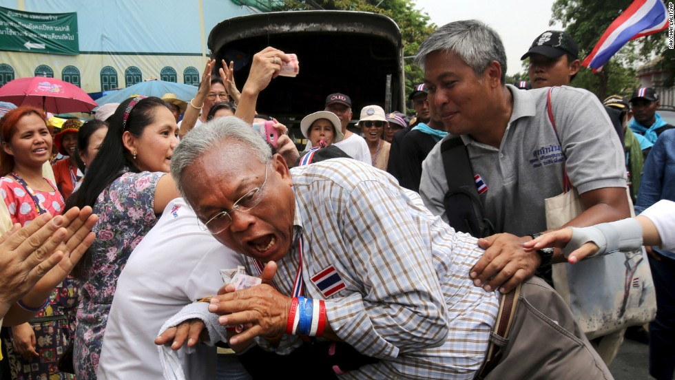 "Suthep Thaugsuban, leader of anti-government protesters in Thailand, reacts as a supporter hugs him during a march in Bangkok on Monday, May 19. Thailand's army announced Thursday, May 22, that it had <a href=""http://www.cnn.com/2014/05/22/world/asia/thailand-martial-law/index.html"">taken control of the country in a coup</a>. The move came after rival factions were unable to come up with a suitable agreement to govern, the military chief said in a national address."