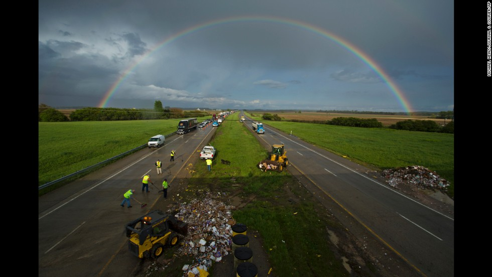 A rainbow is seen over Interstate 74 on Friday, May 16, after a semi-trailer truck collided with a bridge support near Hillsboro, Indiana. The driver of the truck, 42-year-old Dale C. Johnstone Jr., was killed, state police said.