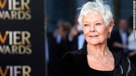 English actress Judi Dench poses for pictures on the red carpet upon arrival to attend the Lawrence Olivier Awards for theatre at the Royal Opera House in central London on April 13, 2014. AFP PHOTO/ANDREW COWIE        (Photo credit should read ANDREW COWIE/AFP/Getty Images)