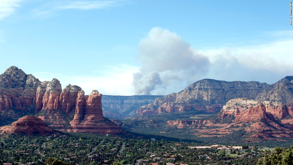 Smoke rises from Oak Creek Canyon in Sedona on May 22.