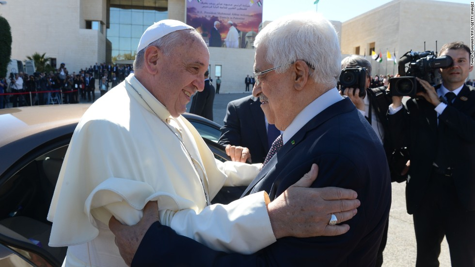 Palestinian President Mahmoud Abbas greets Pope Francis in Ramallah, West Bank, on May 25.