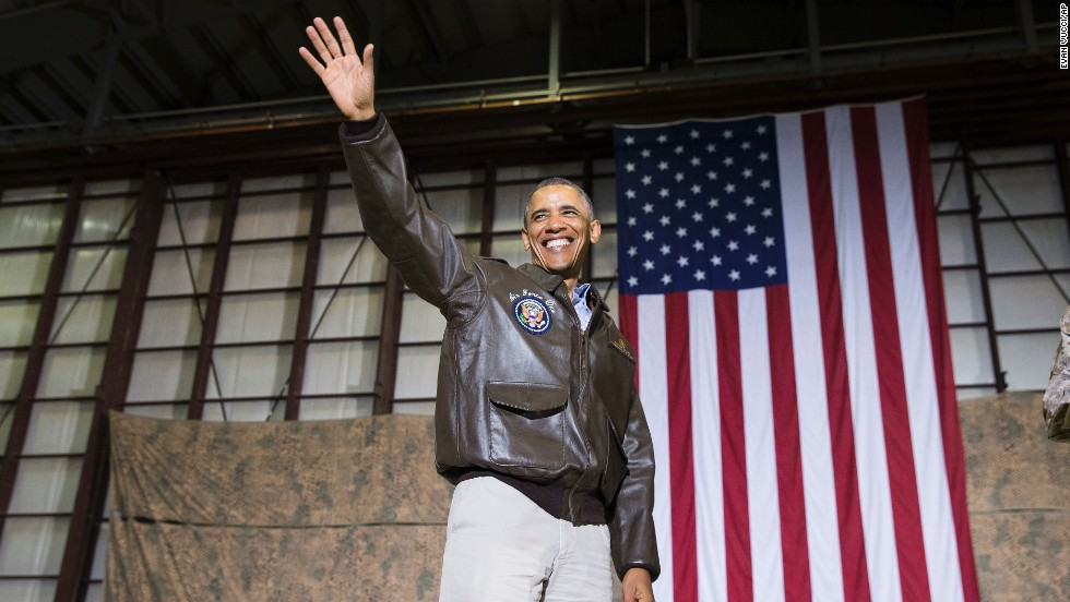 The President waves as he arrives for the troop rally.