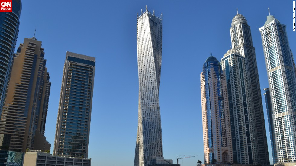 "The 80-story <a href=""http://ireport.cnn.com/docs/DOC-1129094"">Cayan Tower</a> is a residential building in Dubai, United Arab Emirates. ""Its unique helix-shaped design is futuristic because it redefines what one might think of as the 'normal' architectural characteristics of a skyscraper,"" said iReporter Lynda Martinez."