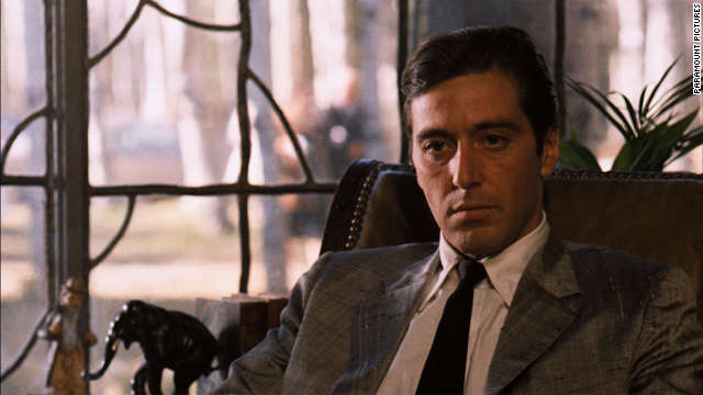 Al Pacino sits in a chair in a scene from the film 'The Godfather: Part II', 1974.
