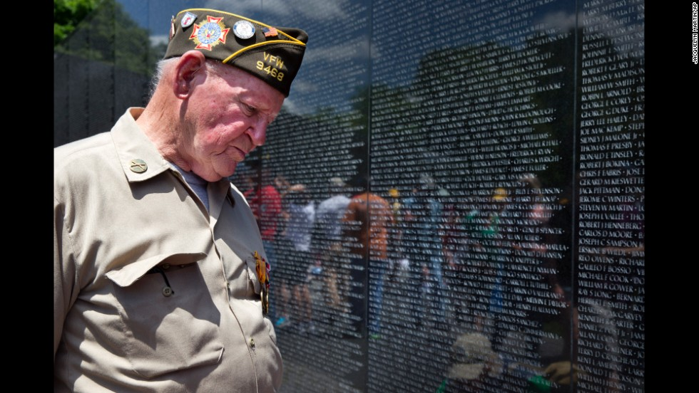 World War II veteran Jimmy Bishop Jr. looks at names on the Vietnam Veterans Memorial in Washington on May 25, 2014.