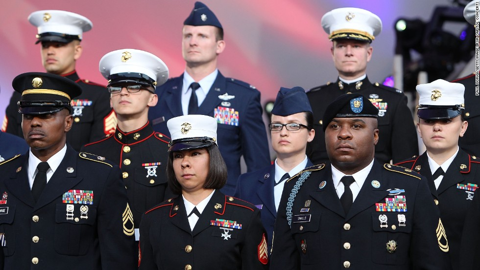 Military personnel stand at attention May 25, 2014, during the National Memorial Day Concert at the Capitol in Washington.