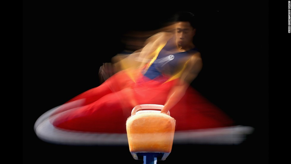 A slow shutter speed was used to grab this photo of gymnast Christopher Rem competing on the pommel horse Saturday, May 24, at the Australian Gymnastics Championships in Melbourne.