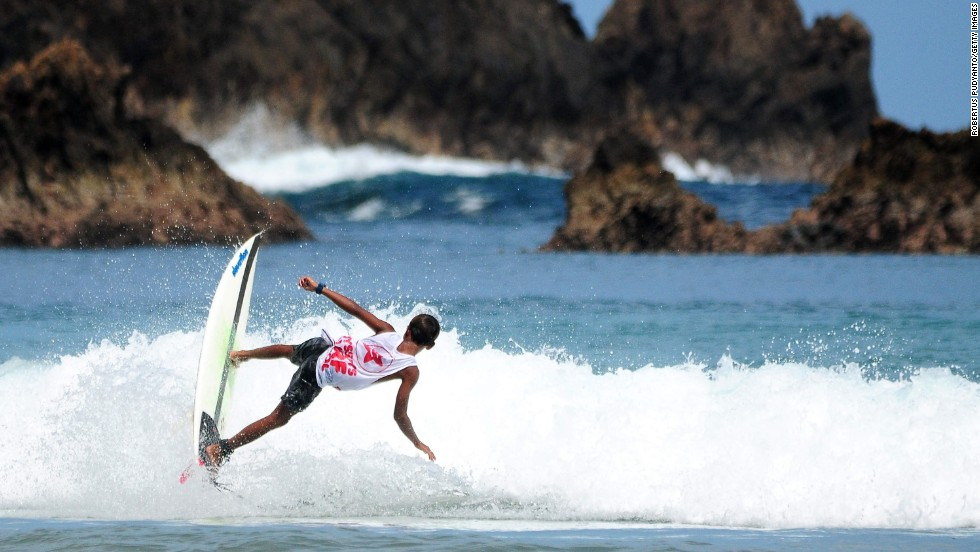 A surfer competes during the Red Island International Surfing Championship on Saturday, May 24, in Banyuwangi, Indonesia.