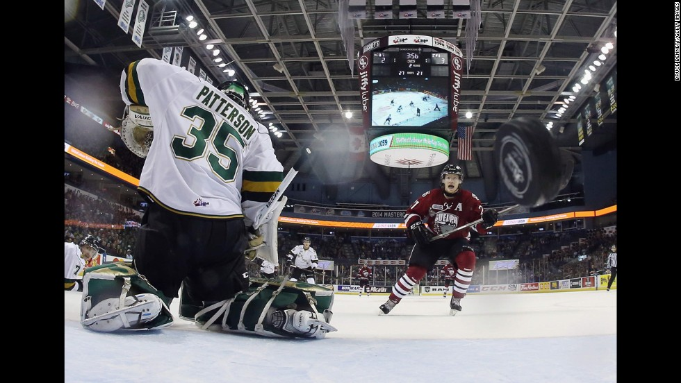 Brock McGinn of the Guelph Storm, right, watches a shot go by Jake Patterson of the London Knights during a Memorial Cup tournament game Wednesday, May 21, in London, Ontario. Guelph won the game 7-2 and advanced to the final of the tournament, which it lost 6-3 to the Edmonton Oil Kings. The Memorial Cup tournament brings together the champions of Canada's various junior hockey leagues.