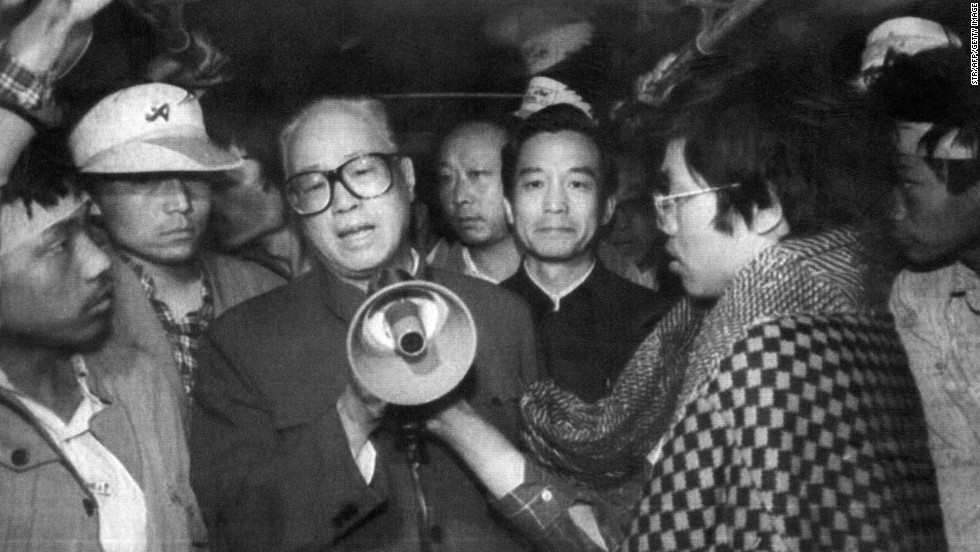 "May 19, 1989, the sixth day of hunger strikes. Communist Party General Secretary Zhao Ziyang arrives at Tiananmen Square to address the students. He begins his now-famous speech by saying: ""Students, we came too late. We are sorry."" The next day, Premiere Li Peng declares martial law in parts of Beijing."