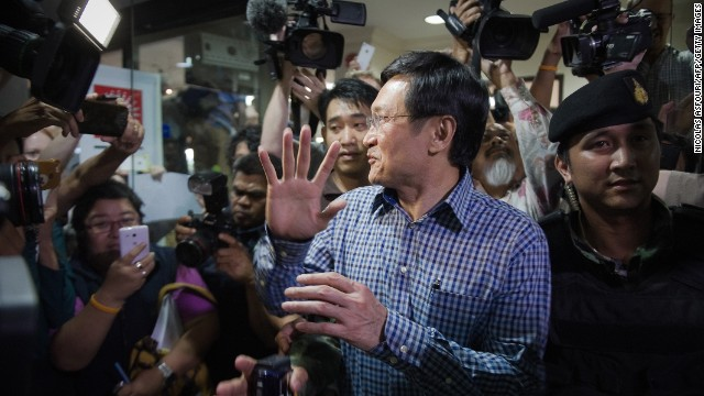 Chaturon Chaisang, who was education minister in the government ousted by the military last week, is arrested by Thai soldiers at the Foreign Correspondents' Club of Thailand in Bangkok on May 27. Thailand's army detained a fugitive former cabinet minister wanted by the ruling junta in a dramatic swoop by soldiers at a packed Bangkok press briefing.