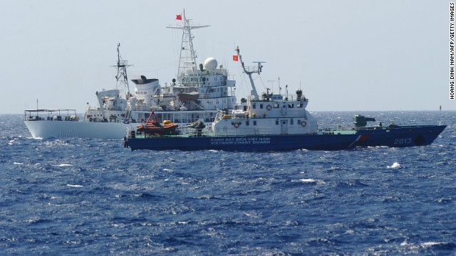 A Chinese coast guard ship (back) shadows a Vietnamese coast guard vessel near the Paracel Islands on May 14.
