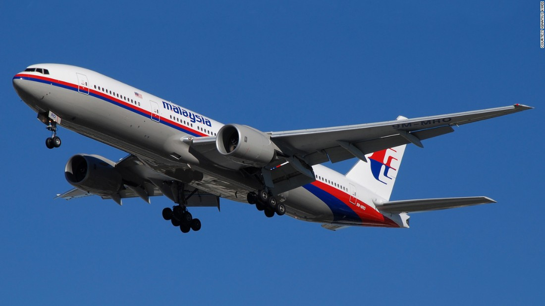 New satellite photos show objects on water near potential MH370 crash site