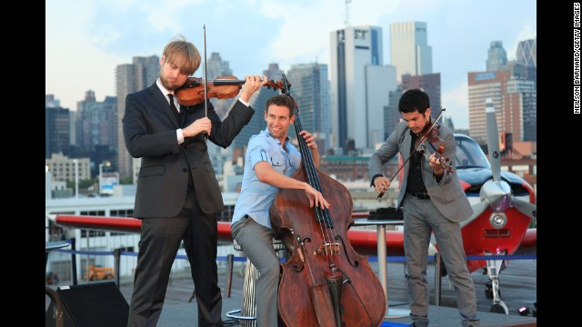 Nick Kendall, Ranaan Meyer and Zachary DePue of Time for Three perform at the inaugural exhibit of vintage Breguet timepieces on board the USS Intrepid on June 14, 2012 in New York City.
