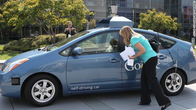 MOUNTAIN VIEW, CA - SEPTEMBER 25: A reporter looks at a Google self-driving car at the Google headquarters on September 25, 2012 in Mountain View, California. California Gov. Jerry Brown signed State Senate Bill 1298 that allows driverless cars to operate on public roads for testing purposes. The bill also calls for the Department of Motor Vehicles to adopt regulations that govern licensing, bonding, testing and operation of the driverless vehicles before January 2015. (Photo by Justin Sullivan/Getty Images)