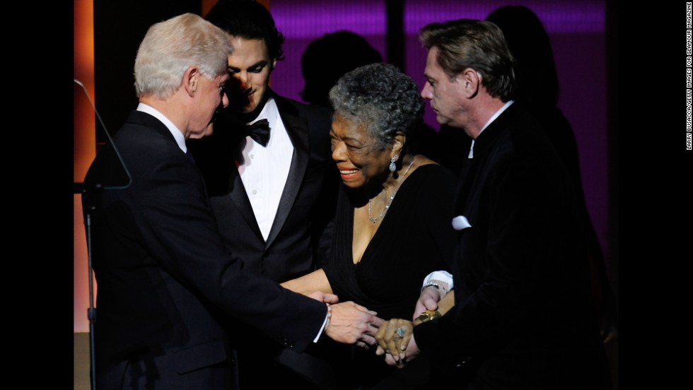Clinton speaks to Angelou on stage at the the 2009 Women of the Year event hosted by Glamour magazine.