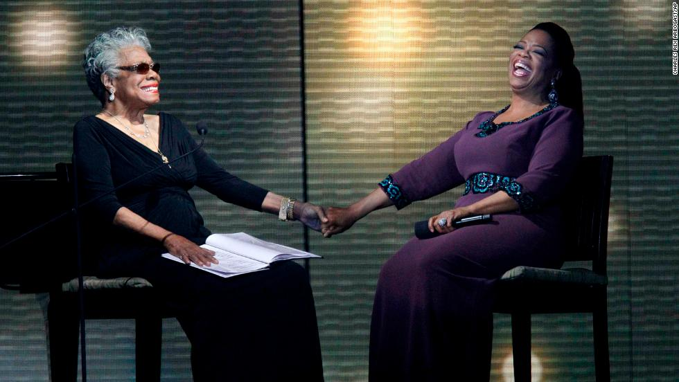 "Angelou and talk show host Oprah Winfrey laugh during the taping of ""Surprise Oprah! A Farewell Spectacular"" in 2011."