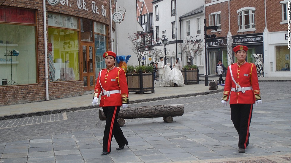 "Thames Town even has its own red coat guards and features quaint additional facilities such as a British pub and tea shop.<br /><br />But according to Gary Hack, the center of this little bit of England just outside Shanghai is often eerily quiet. This is because many of the houses above the shops and boutiques remain unsold as they don't cater for the styles traditionally preferred by Chinese home-buyers, he said. <br /><br />""(But) the high-rise housing in gated communities nearby are selling very well and the individual villas behind walls seem to be largely occupied,"" Hack added. ""Most Chinese home-buyers want the style of the iconic places but they also want the kind of space (and) organization acceptable in Chinese contemporary culture.""  <br /><br />""That usually means gated communities, not houses with front doors on the street."""