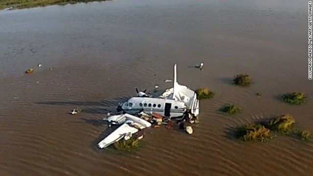 Handout picture released by Uruguay's Air Force showing an Argentine aircraft that crashed in the Rio de la Plata, some 10 km south of Carmelo, in Uruguay on May 27, 2014. Five people died in the accident and the other four, who were injured, were already taken to nearby hospitals.