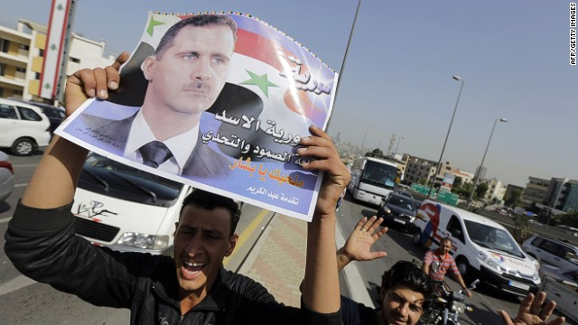 Assad marches to re-election