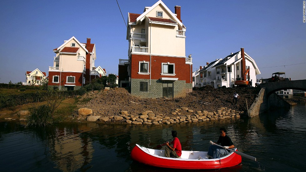 "Two men row past houses built in a northern European style at the Luodian development in Huangzho, China.<br /><br />Bianca Bosker recalls from her own experience that many towns are ""eerie in their emptiness."" But she is quick to add that this certainly isn't a uniform trend across all developments.<br /><br />""When you go to other less well known copycat towns, many of them really are bustling and you see families and kids and a car in every garage,"" she said. <br /><br />""On the other hand there is a lot of speculation in China's real-estate market. There are a lot of people buying up a lot of property and holding on to it in the hope that the price will go up in the future.<br /><br />""As a result you have developers who are just building acres and acres with tons of people to buy it but nobody to live in it."""