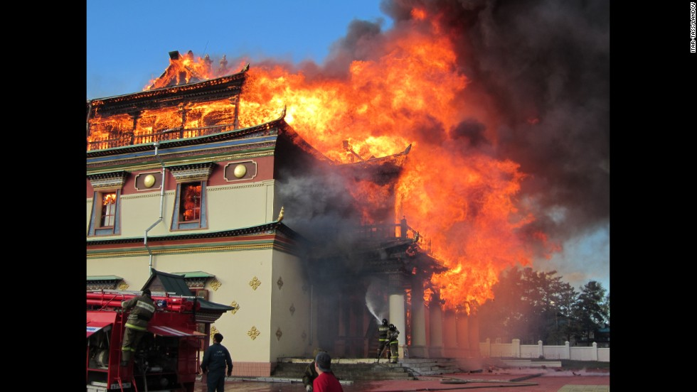 Firefighters put out a blaze that erupted in the main temple of a Buddhist monastery Wednesday, May 28, in Amitkhasha, Russia.