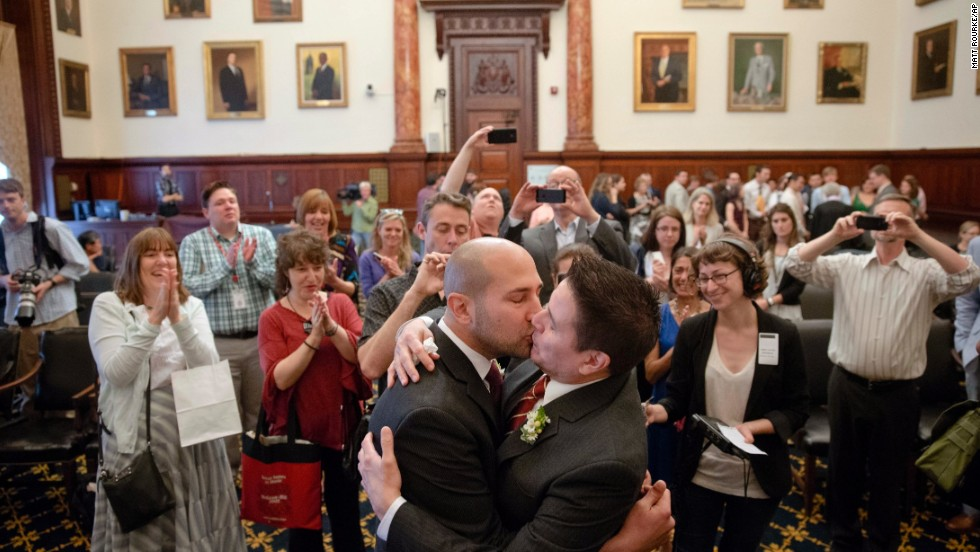 Christopher DiCapua, left, and Oscar Cabrera kiss after saying their wedding vows Friday, May 23, at Philadelphia's City Hall. Earlier in the week, Pennsylvania's governor said he would not appeal a federal judge's ruling that overturned the state's 1996 ban against same-sex marriage.
