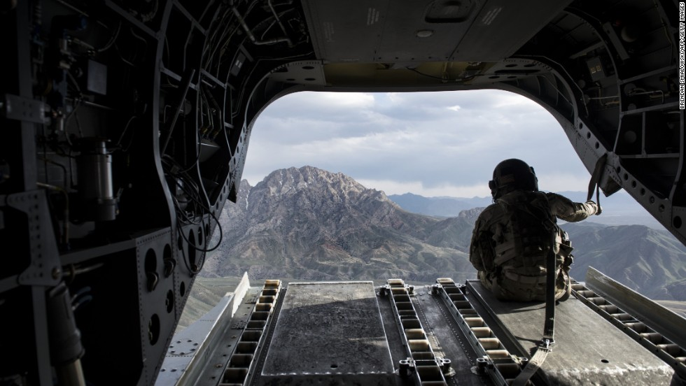 A U.S. soldier looks at an Afghan mountain range from a Chinook helicopter on Wednesday, May 28. U.S. forces could complete their withdrawal from Afghanistan by the end of 2016, President Obama said, unveiling a plan to end America's longest war.