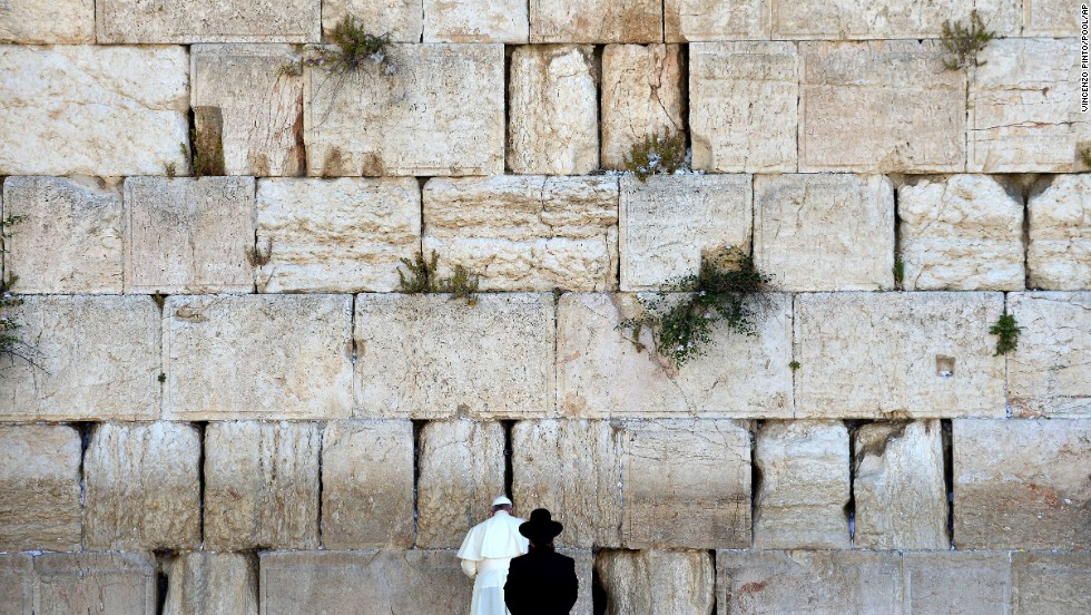 "Pope Francis prays next to a rabbi at the Western Wall in Jerusalem's Old City on Monday, May 26. The Pope went on a <a href=""http://www.cnn.com/2014/05/24/world/gallery/pope-holy-land/index.html"">three-day trip to the Holy Land</a>, and he was accompanied by Jewish and Muslim leaders from his home country of Argentina."