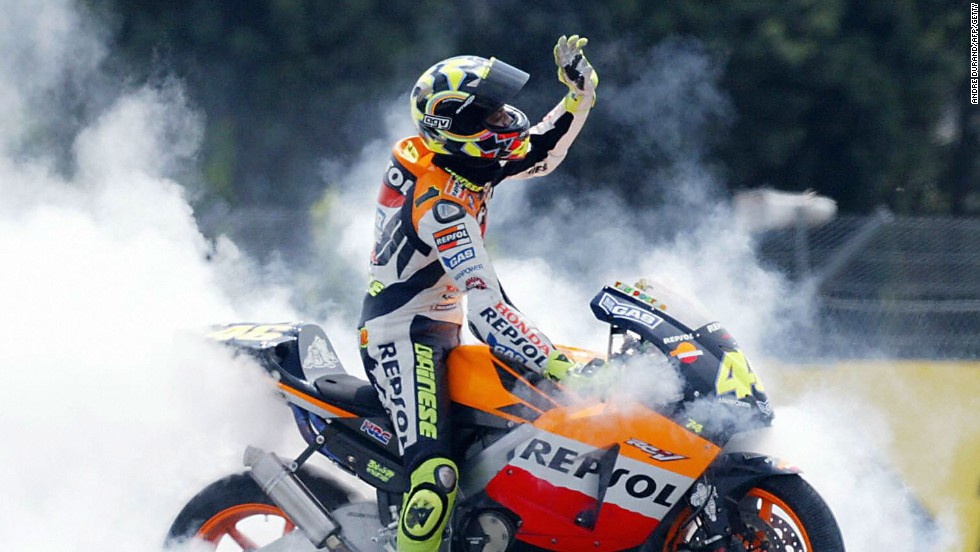 Ever the showman. Rossi produces a sea of burning tire smoke as he celebrates yet another MotoGP victory.