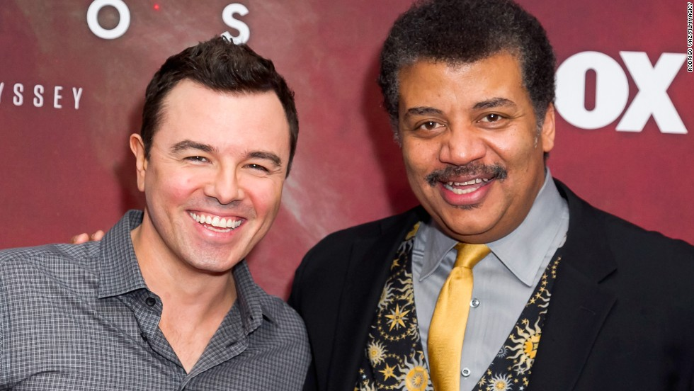 "MacFarlane poses with astrophysicist Neil deGrasse Tyson at the premiere of Fox's ""Cosmos: A SpaceTime Odyssey"" at The Greek Theatre in March 2014 in Los Angeles, California. MacFarlane is executive producer of the series."