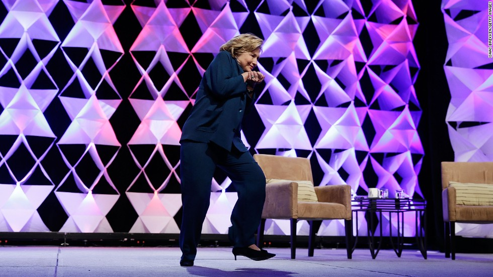 Clinton ducks after a woman threw a shoe at her while she was delivering remarks at a recycling trade conference in Las Vegas in 2014.