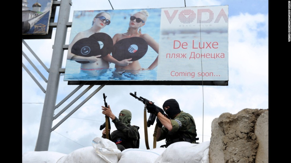 Pro-Russian militants stand guard at a barricade and checkpoint in Donetsk on Sunday, June 1.