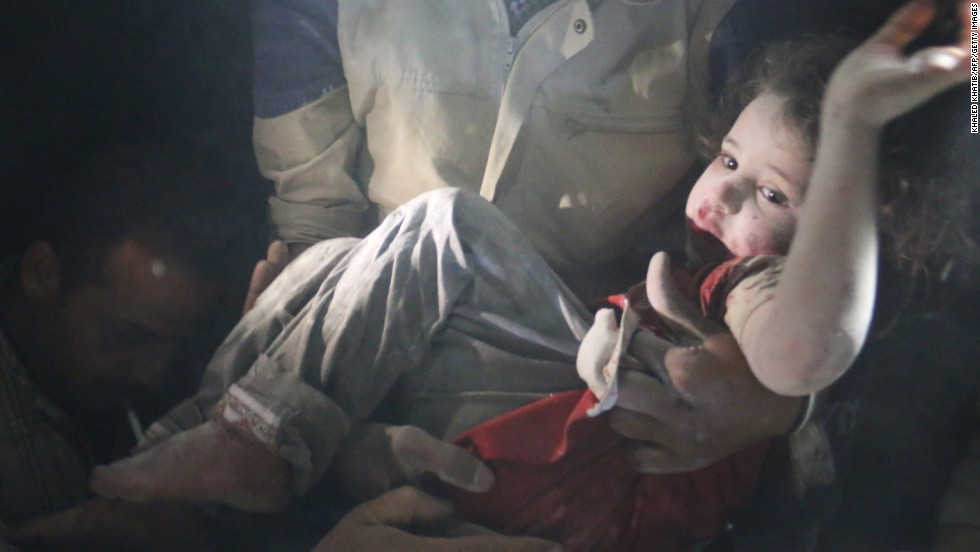 A rescue worker pulls a girl from rubble in Aleppo on June 1 after reported bombing by government forces.