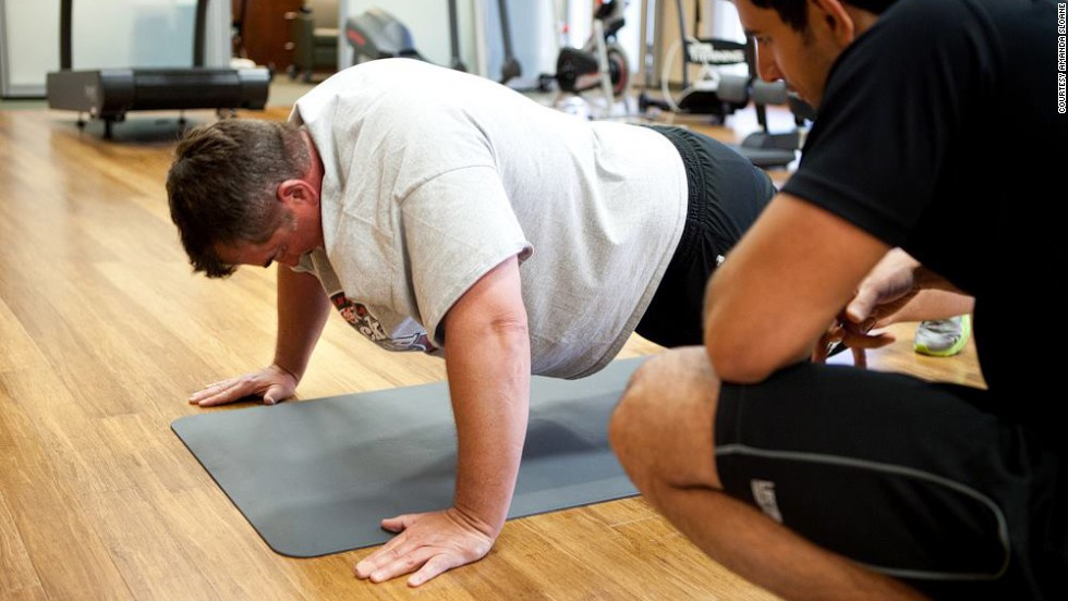 "Mike Wilber works his arms and core in the plank position. ""The midway trip turned into a personal journey for me,"" Wilber said. ""It wasn't the physical challenge as much as a mental challenge. Something that I thought I couldn't do or wouldn't be able to do -- and now I have done it."""